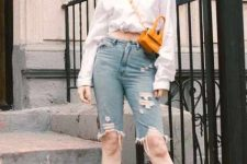 With white long sleeve shirt, distressed denim bermuda shorts, yellow bag and ankle strap shoes