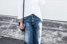 With white loose button down shirt, black bag and black flat shoes