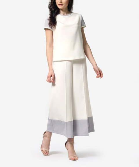 With white loose shirt and beige ankle strap shoes