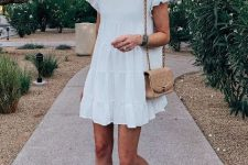 With white mini dress and chain strap bag