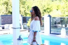 With white off the shoulder dress and high heels