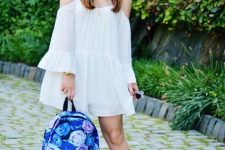 With white off the shoulder romper and brown sandals