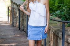With white one shoulder ruffled top and white flat sandals