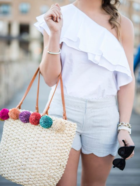 With white one shoulder top and striped shorts