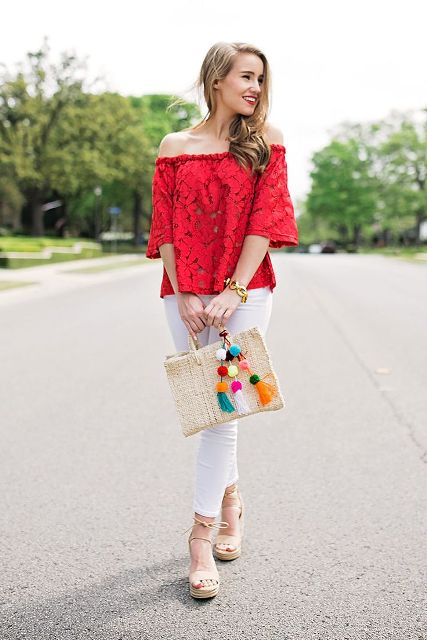 With white pants, platform sandals and pom pom bag