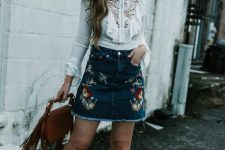 With white ruffled blouse, brown fringe bag and brown boots