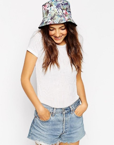 With white shirt and denim shorts