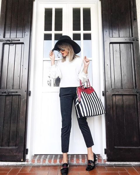 With white shirt, printed cropped pants, black hat and black shoes
