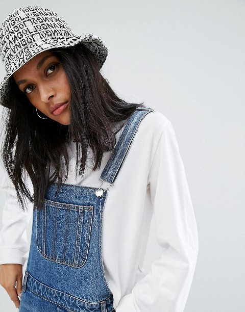 With white sweatshirt and denim jumpsuit