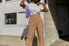 With white t-shirt, beige high-waisted trousers, white shoes and lilac bag