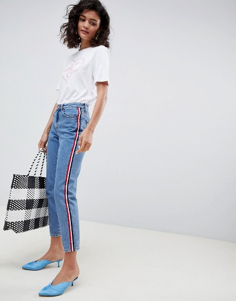 With white t shirt, checked tote bag and light blue mules