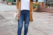 With white t-shirt, distressed jeans, brown cardigan and gray bag