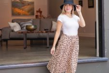With white t-shirt, printed skirt and black ankle strap shoes