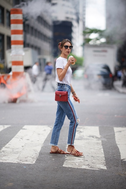 With white t-shirt, red chain strap bag and brown flat sandals