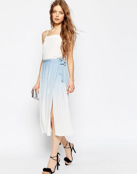 With white top, silver clutch and black lace up high heels