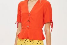 With yellow and black polka dot midi skirt