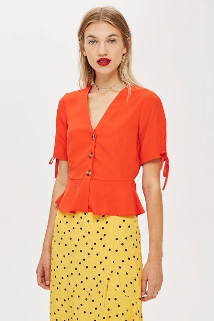 With yellow and black polka dot midi skirt