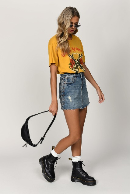 With yellow t shirt, waist bag, white socks and black lace up boots
