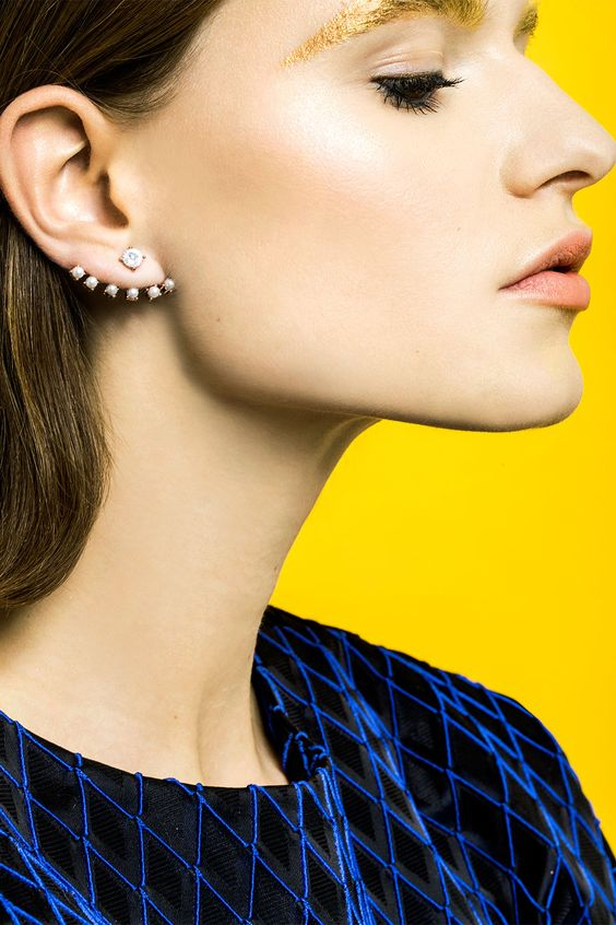 a beautiful and bold ear jacket with a crystal dot and pearls is a lovely and bold take on classics
