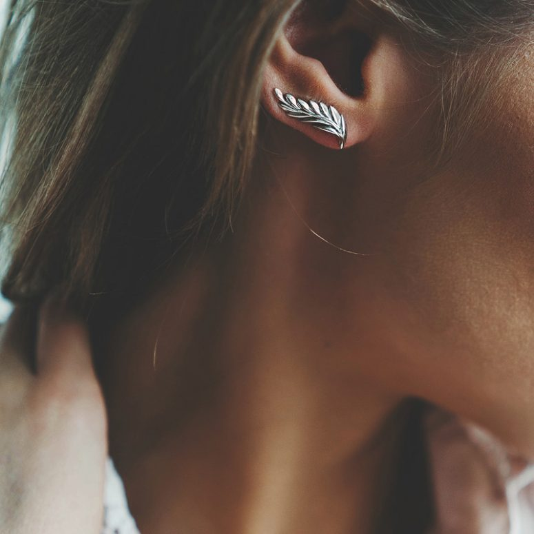 a beautiful silver feather climber earring is a lovely accessory for adding a boho touch to the look