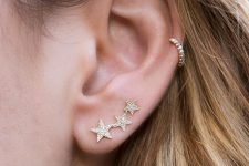 a beautiful star and rhinestone climber earring and a matching rhinestone hoop for chic ear accessorizing