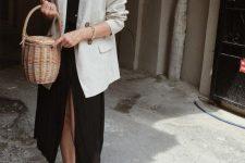 a black midi dress on buttons, a creamy oversized blazer, black slippers and a basket bag