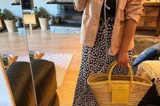 a black printed tee, a polka dot midi skirt, black heels, a tan denim jacket and a hot yellow raffia bag