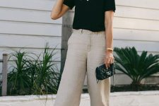 a black tee, neutral linen pants, black slippers and a black bag to wear to work this summer