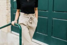 a black tee, neutral paperbag wideleg pants and leather mules for a comfortable and trendy look