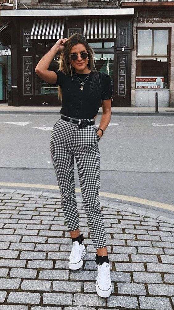 a black tee, plaid high waisted pants, white sneakers and black socks plus layered necklaces
