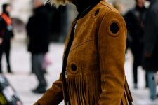 a black turtleneck, blue jeans and a rust-colored fringe cropped suede jacket for the fall