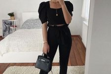 an all-black summer night out look