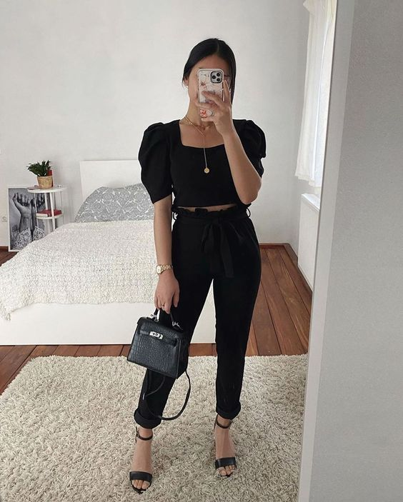 a chic night out look with a black puff sleeve crop top, black pants, heels and a small bag is wow