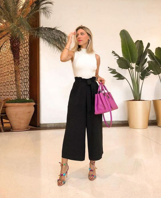 a chic summer work look with a white halter top, black culottes, colorful heels and a purple bag