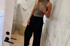 a chic work outfit with a grey halter top, black pants, black heels for an ultra-minimal look