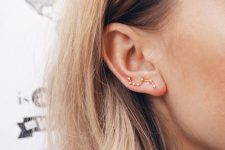 a constellation gold and rhinestone climber earring wil help you give a celestial touch to the look