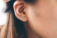a curved arrow climber earring is a nice solution for a boho outfit and it looks fun