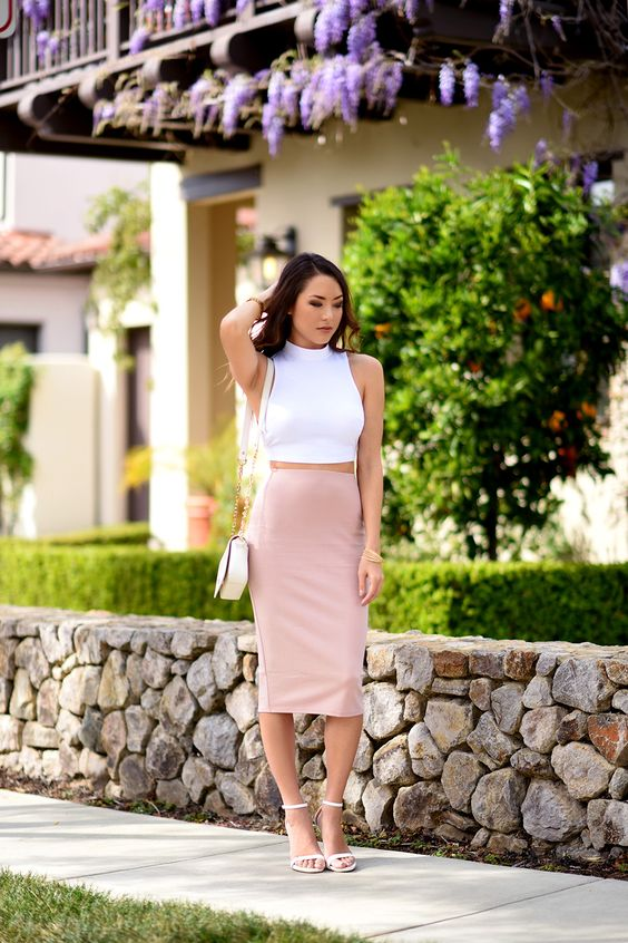 a date outfit with a white halter crop top, a blush midi pencil skirt, white heels and a white bag
