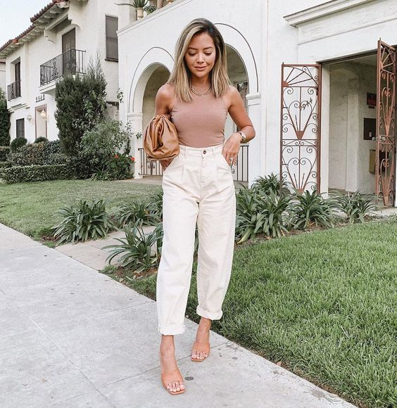 a dusty pink sleeveless top, creamy slouchy pants, tan mules and a brown clutch for work