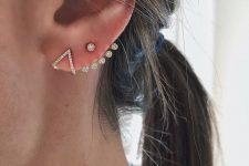 a glam stud jacket earring and a geometric crystal earring for a bold and matching look