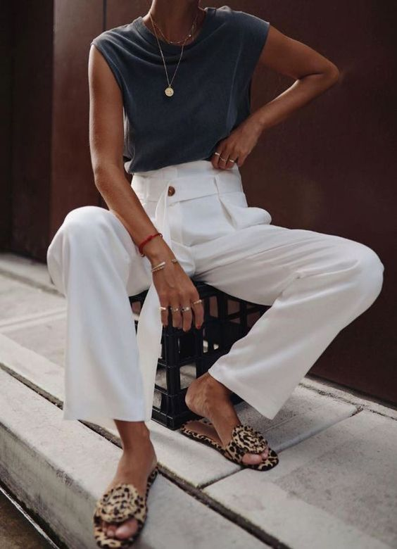 a graphite grey cap sleeve top, white high waisted pants, leopard slippers and layered necklaces