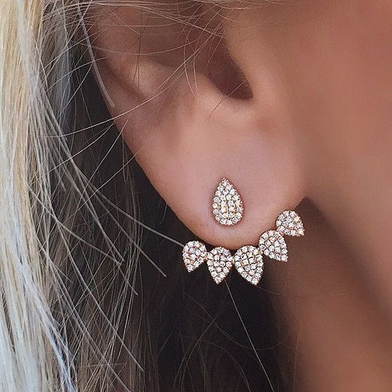 a lovely and elegant drop-shaped ear jacket of gold and rhinestones is romantic and vintage-inspired