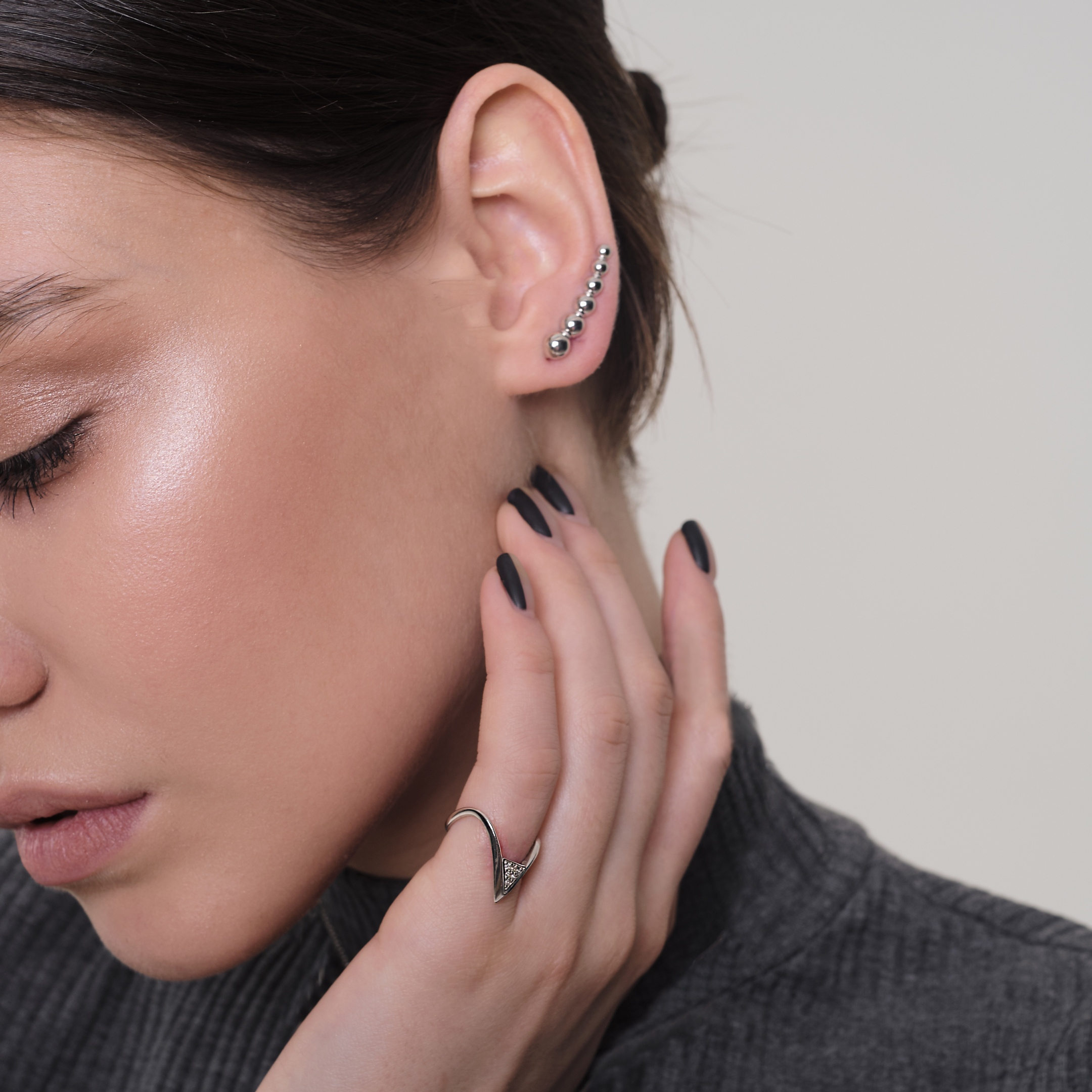 a minimalist silver stud climber earring is a nice accessory for a minimalist look and it will fit many situations