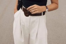 a monochromatic work look with a black halter top, white Bermuda shorts, a black bag and slippers