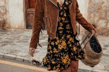 a moody floral mini dress, black combat boots, a brown suede jacket with fringe on the sleeves