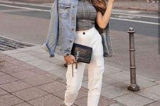 a plaid crop top, creamy cargo pants, white sneakers, a blue denim jacket and a black clutch