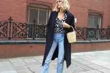 a printed shirt, blue jeans, tan velvet booties, a navy midi coat and a basket bag