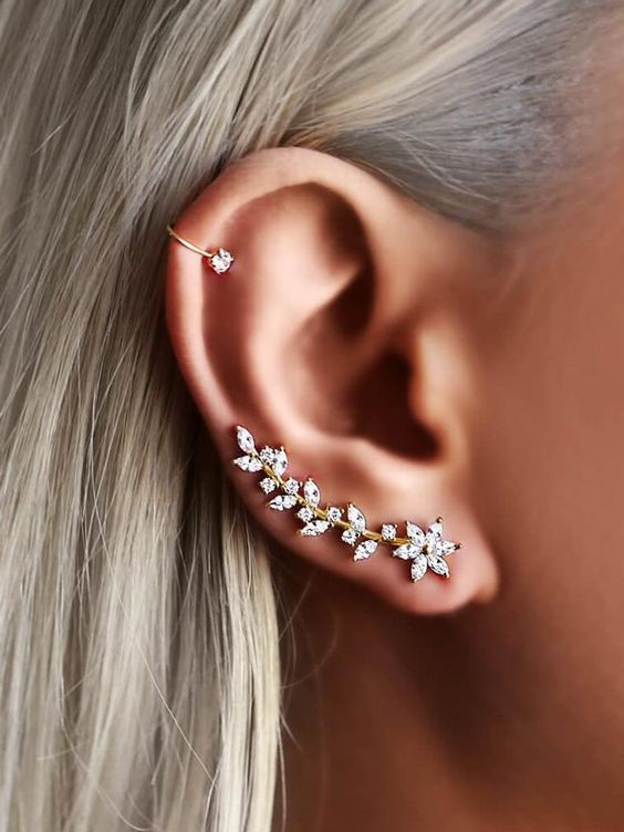 a refined floral and botanical gold and rhinestone climber earring and a matching ear cuff on the helix