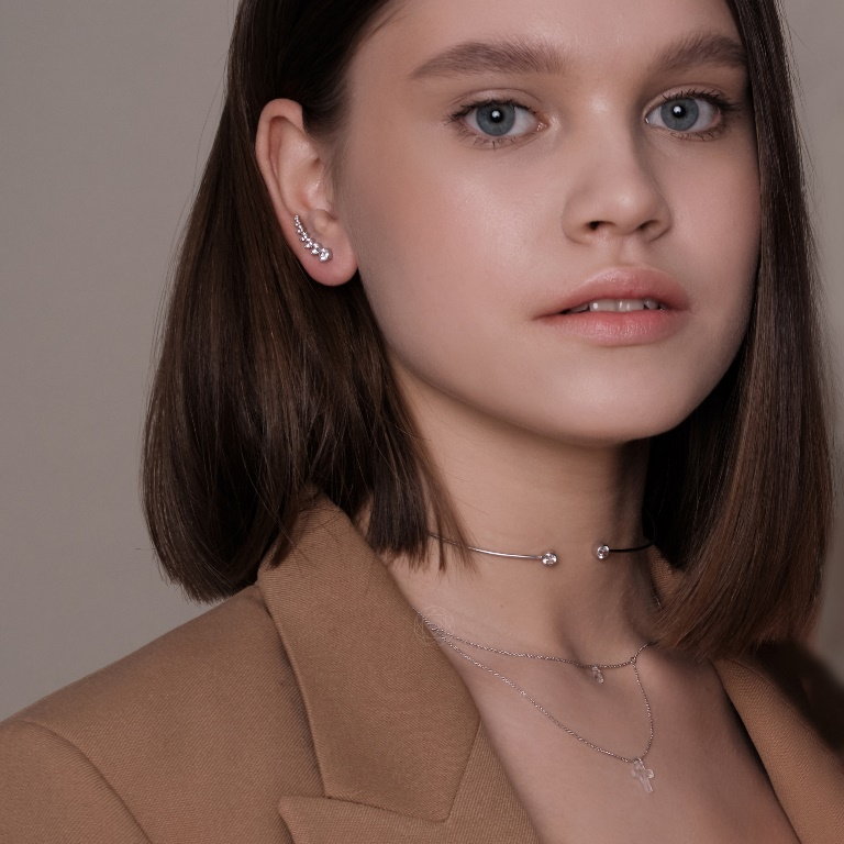 a silver and rhinestone climber earring plus a matching silver choker necklace for a super bold look