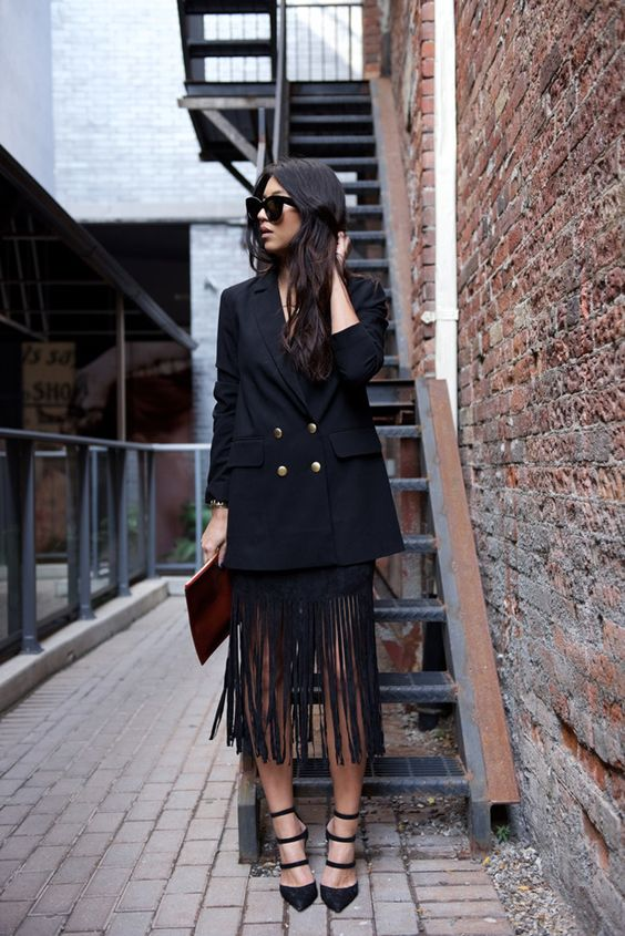 a special date look with a black top and fringe midi skirt, strappy heels and an oversized blazer